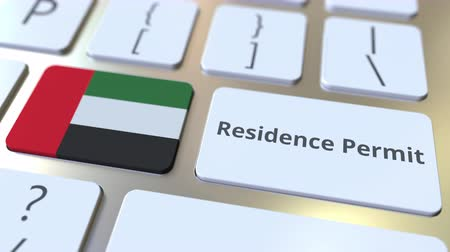 reside : Residence Permit text and flag of the United Arab Emirates UAE on the buttons on the computer keyboard. Immigration related conceptual 3D animation Stock Footage