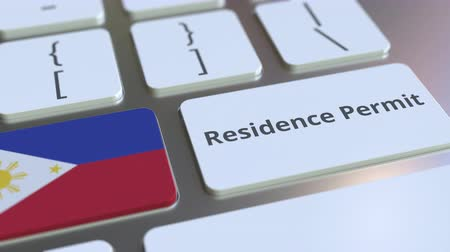 reside : Residence Permit text and flag of Philippines on the buttons on the computer keyboard. Immigration related conceptual 3D animation Stock Footage