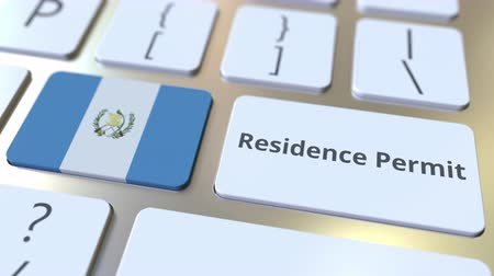 expat : Residence Permit text and flag of Guatemala on the buttons on the computer keyboard. Immigration related conceptual 3D animation Stock Footage
