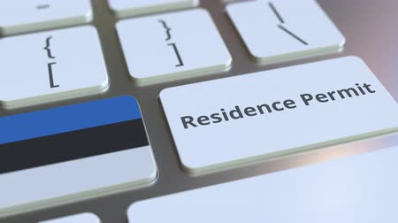 reside : Residence Permit text and flag of Estonia on the buttons on the computer keyboard. Immigration related conceptual 3D animation Stock Footage