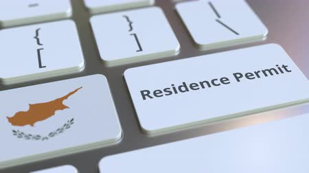 reside : Residence Permit text and flag of Cyprus on the buttons on the computer keyboard. Immigration related conceptual 3D animation Stock Footage