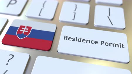 göçmen : Residence Permit text and flag of Slovakia on the buttons on the computer keyboard. Immigration related conceptual 3D animation Stok Video