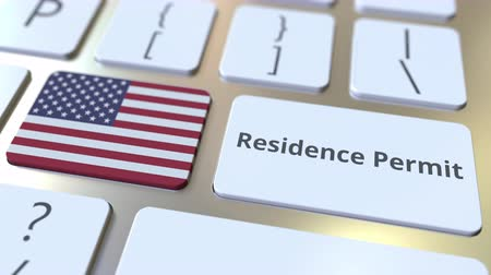 expat : Residence Permit text and flag of the USA on the buttons on the computer keyboard. Immigration related conceptual 3D animation Stock Footage