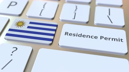 reside : Residence Permit text and flag of Uruguay on the buttons on the computer keyboard. Immigration related conceptual 3D animation