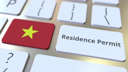 göçmen : Residence Permit text and flag of Vietnam on the buttons on the computer keyboard. Immigration related conceptual 3D animation Stok Video