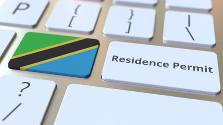 reside : Residence Permit text and flag of Tanzania on the buttons on the computer keyboard. Immigration related conceptual 3D animation Stock Footage