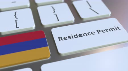 göçmen : Residence Permit text and flag of Armenia on the buttons on the computer keyboard. Immigration related conceptual 3D animation