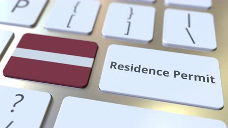 reside : Residence Permit text and flag of Latvia on the buttons on the computer keyboard. Immigration related conceptual 3D animation