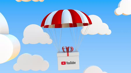 abbonamento : YOUTUBE logo on moving box moves under parachute. Editorial loopable 3D animation Filmati Stock