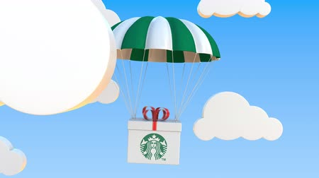 padák : STARBUCKS logo on moving box moves under parachute. Editorial loopable 3D animation Dostupné videozáznamy