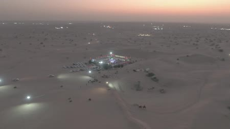 show off : Aerial shot of a desert camp in the evening, United Arab Emirates UAE