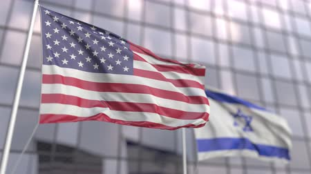 asociacion : Waving flags of the USA and Israel in front of a modern skyscraper facade Archivo de Video
