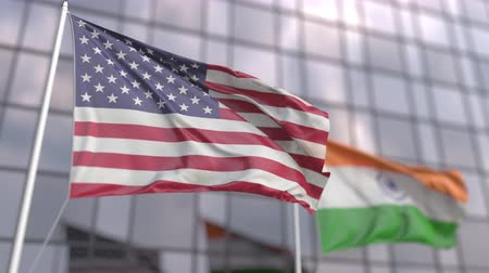 foreign national : Flags of the United States and India in front of a modern skyscraper facade Stock Footage