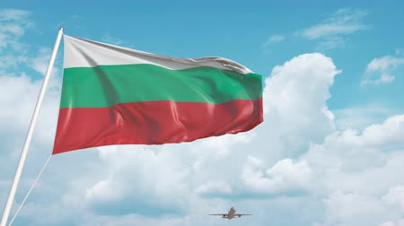 bolgár : Commercial airplane landing behind the Bulgarian flag. Tourism in Bulgaria Stock mozgókép