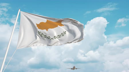 kıbrıs : Airliner approaches the Cypriot national flag. Tourism in Cyprus