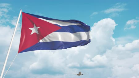 arrive : Airliner approaches the Cuban national flag. Tourism in Cuba