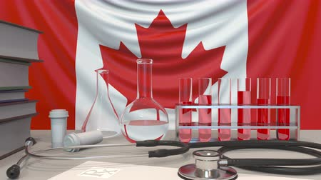 пробирка : Clinic laboratory equipment on Canadian flag background. Healthcare and medical research in Canada related conceptual animation Стоковые видеозаписи