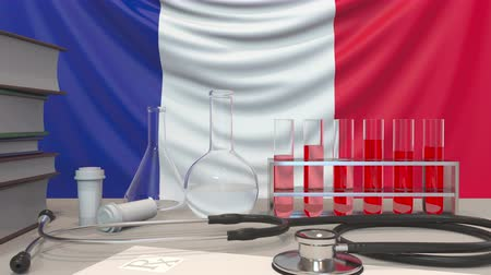 пробирка : Clinic laboratory equipment on French flag background. Healthcare and medical research in France related conceptual animation