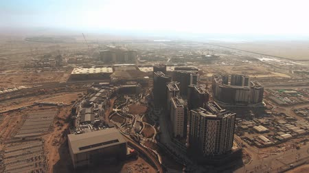 crane fly : DUBAI, UNITED ARAB EMIRATES - DECEMBER 29, 2019. Aerial view of the DUBAI EXPO 2020 buildings under construction