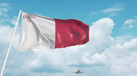 Мальта : Airliner approaches the Maltese national flag. Tourism in Malta