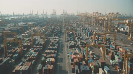 container terminal : DUBAI, UNITED ARAB EMIRATES - DECEMBER 29, 2019. Aerial dolly zoom shot of big Jebel Ali container port