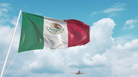 chegar : Airliner approaches the Mexican national flag. Tourism in Mexico