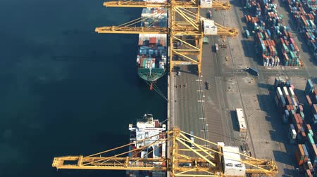 docked : DUBAI, UNITED ARAB EMIRATES - DECEMBER 29, 2019. Aerial view of Jebel Ali port berth and docked cargo ships