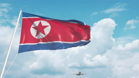 dprk : Commercial airplane landing behind the North Korean flag Stock Footage