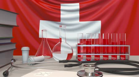 therapeutic : Clinic laboratory equipment on Swiss flag background. Healthcare and medical research in Switzerland related conceptual animation Stock Footage
