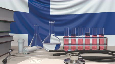 пробирка : Clinic laboratory equipment on Finnish flag background. Healthcare and medical research in Finland related conceptual animation