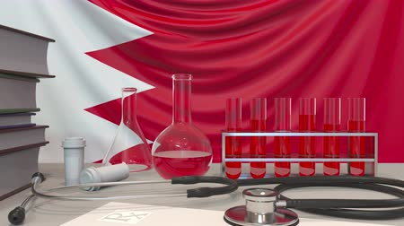 koşullar : Clinic laboratory equipment on Bahraini flag background. Healthcare and medical research in Bahrain related conceptual animation