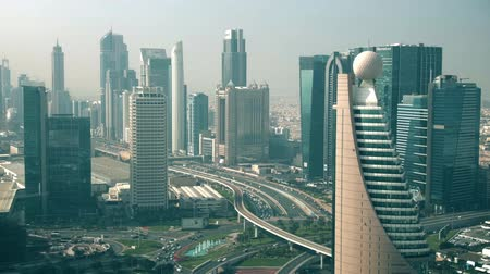 sheraton : DUBAI, UNITED ARAB EMIRATES - DECEMBER 30, 2019. Aerial view of National Bank of Abu Dhabi NBAD and Dubai World Trade Centre Stock Footage