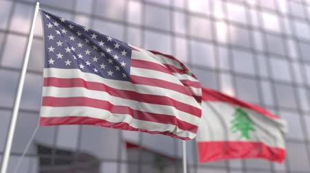 ассоциация : Waving flags of the USA and Lebanon in front of a modern skyscraper facade