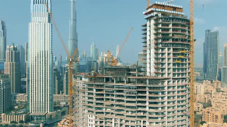 central business district : DUBAI, UNITED ARAB EMIRATES - DECEMBER 30, 2019. Aerial view of the new skyscraper construction site near Burj Khalifa Stock Footage