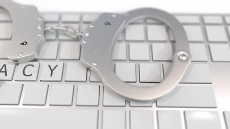 korsan : Handcuffs on keyboard with PIRACY text on keys. Computer crime related conceptual 3D animation