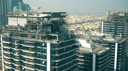 dach : Aerial view of a skyscraper construction site details. Dubai, UAE