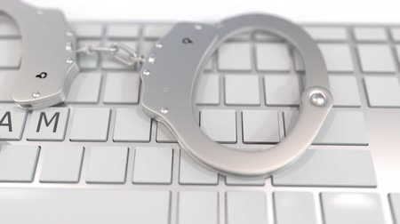 penas : Handcuffs on keyboard with SCAM text on keys. Computer crime related conceptual 3D animation