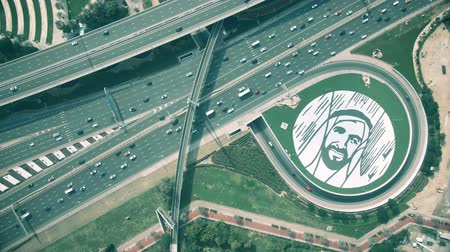 muslim leader : DUBAI, UNITED ARAB EMIRATES - DECEMBER 26, 2019. Aerial top down view of Sheikh Zayed bin Sultan Al Nahyan portrait on the road interchange