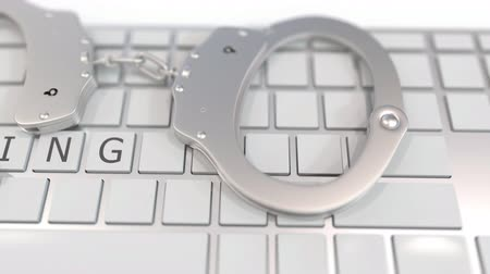 penas : Handcuffs on keyboard with SPYING text on keys. Computer crime related conceptual 3D animation