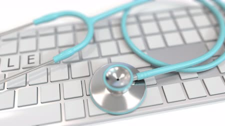 telemedicine : Stethoscope on keyboard with TELE text on keys. Modern telemedicine related conceptual 3D animation