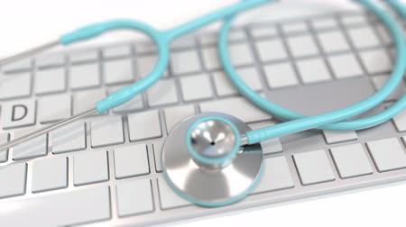 arbeidsomstandigheden : Stethoscope on keyboard with MED text. Modern medicine related conceptual 3D animation