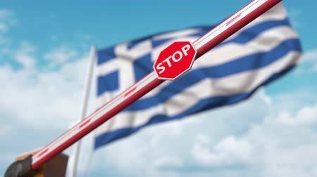 greek flag : Closed boom gate on the Greek flag background. Restricted entry or certain ban in Greece
