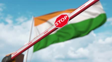 определенный : Barrier gate being closed with flag of India as a background. Indian restricted entry or certain ban Стоковые видеозаписи