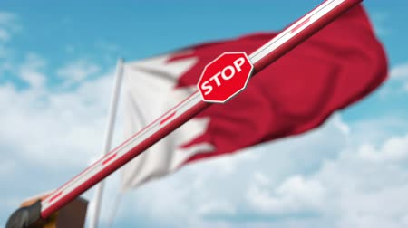 определенный : Closed boom gate on the Bahraini flag background. Restricted entry or certain ban in Bahrain Стоковые видеозаписи