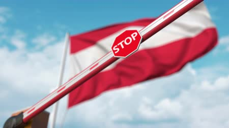 определенный : Closed boom gate on the Austrian flag background. Restricted entry or certain ban in Austria Стоковые видеозаписи