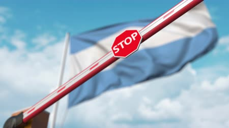 определенный : Closed boom gate on the Argentinean flag background. Restricted entry or certain ban in Argentina Стоковые видеозаписи