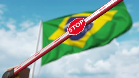 определенный : Closed boom gate on the Brazilian flag background. Restricted entry or certain ban in Brazil