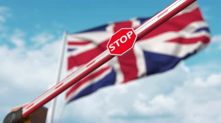запретить : Barrier gate being closed with flag of Great Britain as a background. British restricted entry or certain ban