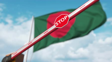 определенный : Barrier gate being closed with flag of Bangladesh as a background. Bangladeshi restricted entry or certain ban