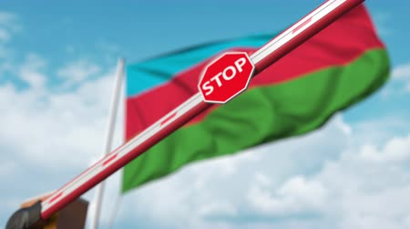 определенный : Closing boom barrier with stop sign against the Azerbaijani flag. Restricted entry or certain ban in Azerbaijan